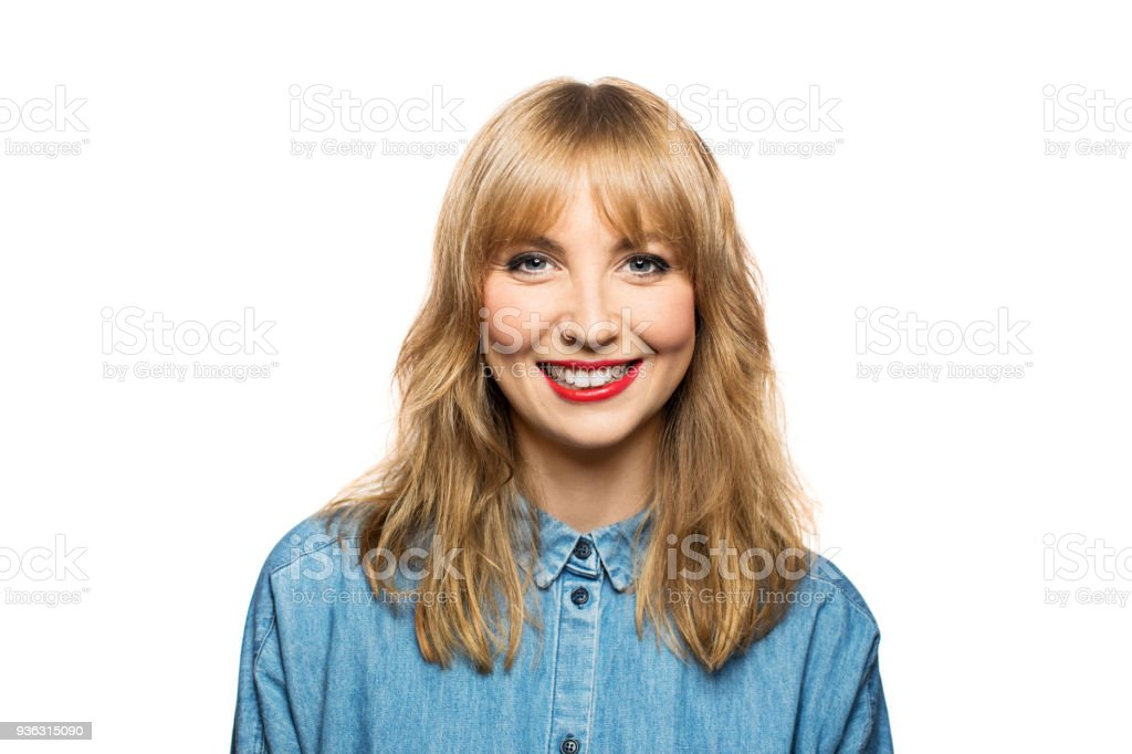 Cheerful young female against white background stock photo