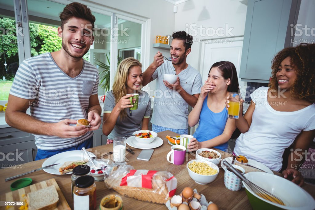 Cheerful young friends holding drinks royalty-free stock photo