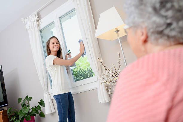cheerful young girl helping with household chores elderly woman home – Foto