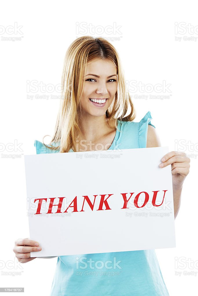 Cheerful young girl with thank you sign. royalty-free stock photo