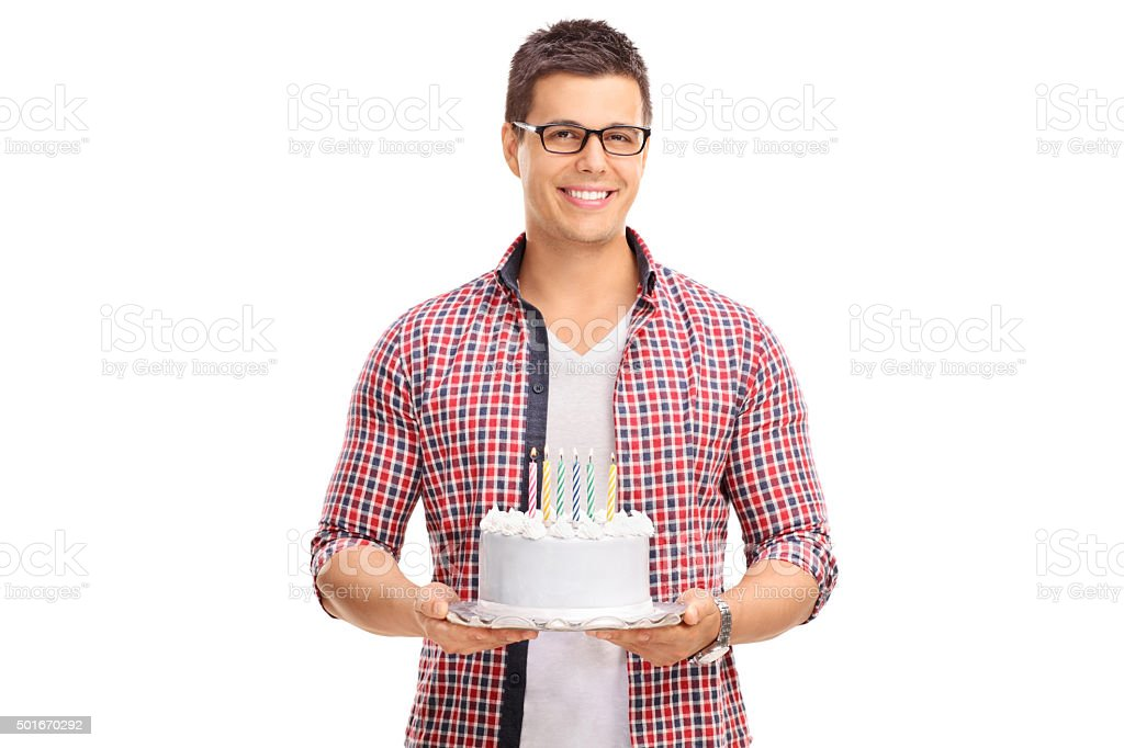 Enjoyable Cheerful Young Guy Holding A Birthday Cake Stock Photo Download Personalised Birthday Cards Beptaeletsinfo