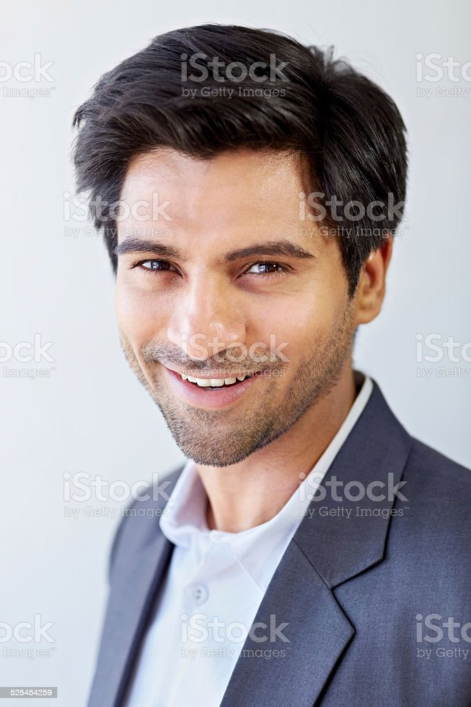 Cheerful young Indian businessman stock photo