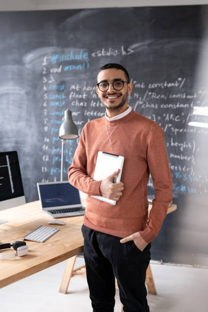 Cheerful young IT specialist stock photo