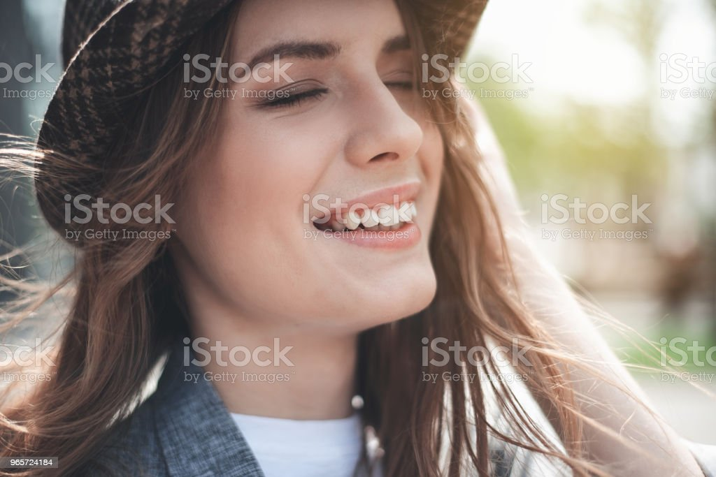 Cheerful young lady is smiling outside - Royalty-free Adult Stock Photo