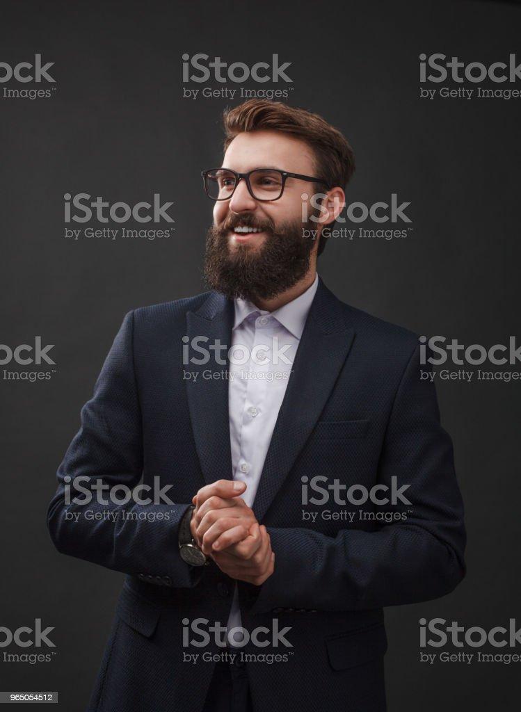 Cheerful young man in suit zbiór zdjęć royalty-free