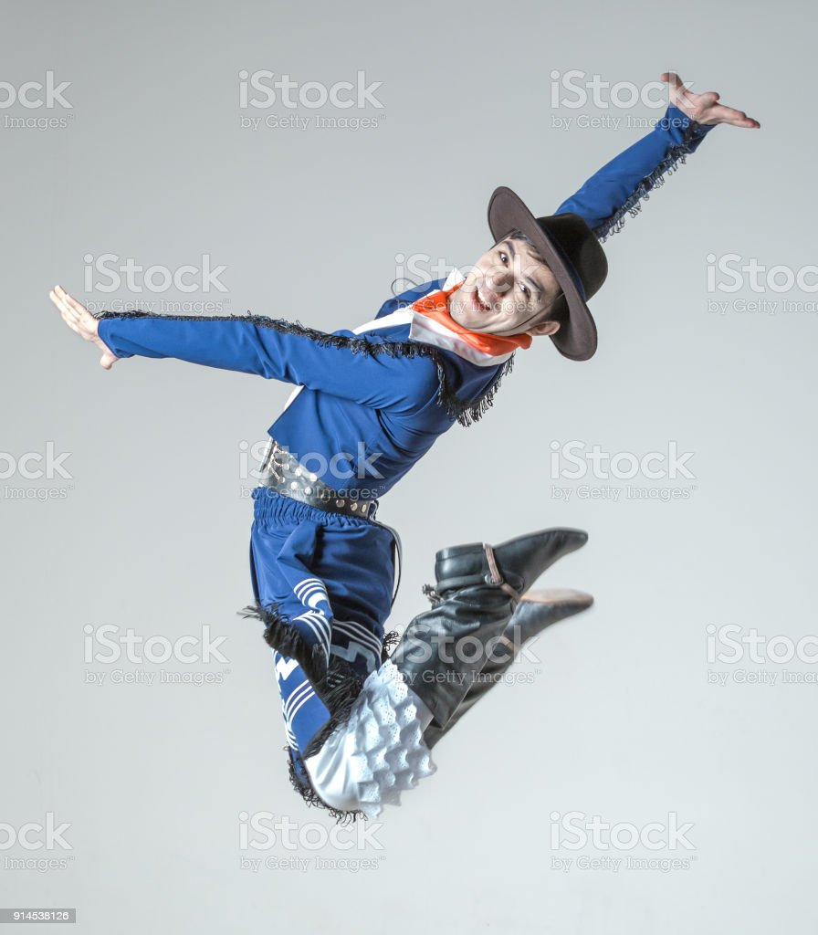 Cheerful Young Man Is Jumping in Hispanic Dance stock photo
