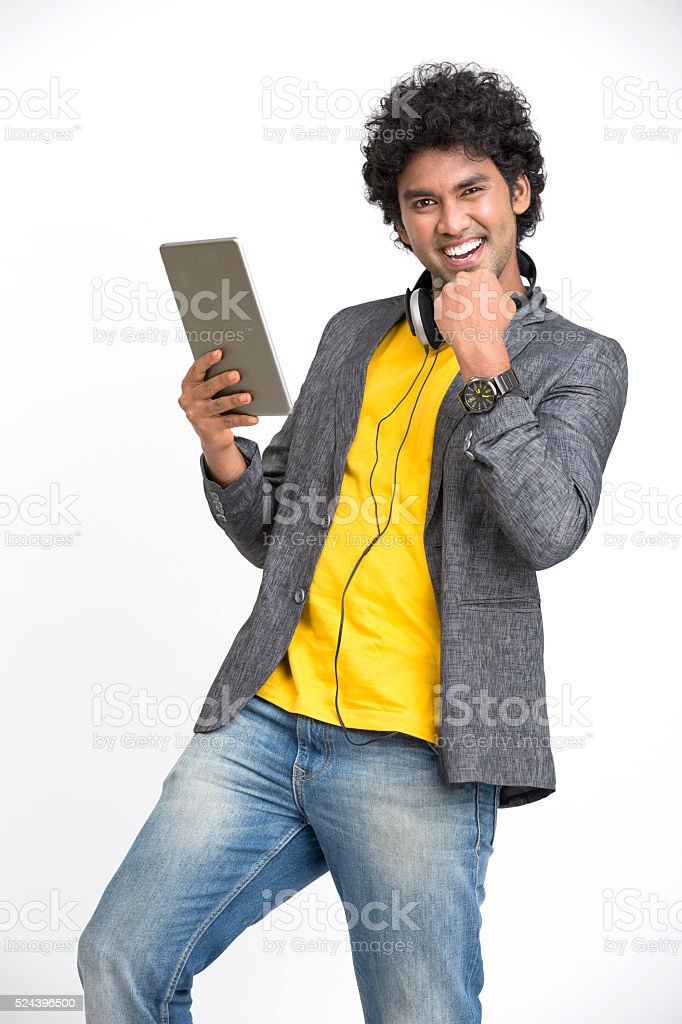 Cheerful Young Man showing success sign with Digital Tablet stock photo