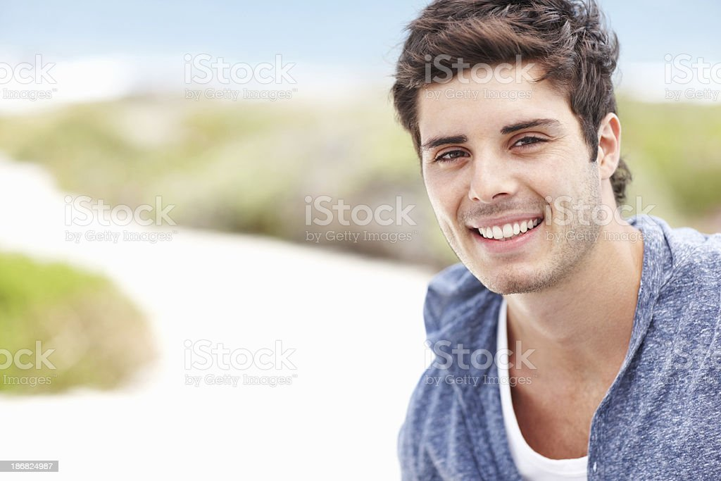 Cheerful young man smiling royalty-free stock photo
