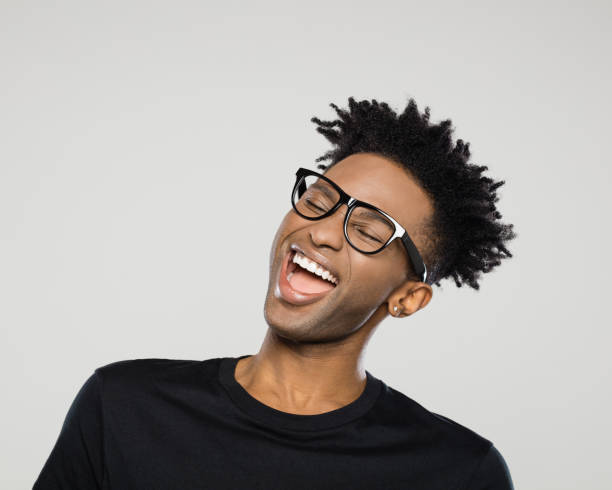 Cheerful young man with nerdy glasses stock photo
