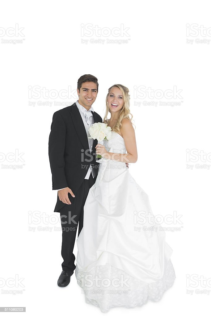 Cheerful young married couple posing smiling at camera stock photo