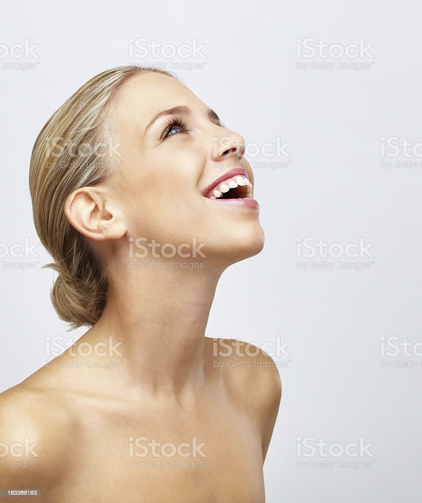 Cheerful Young Naked Woman Isolated Against White