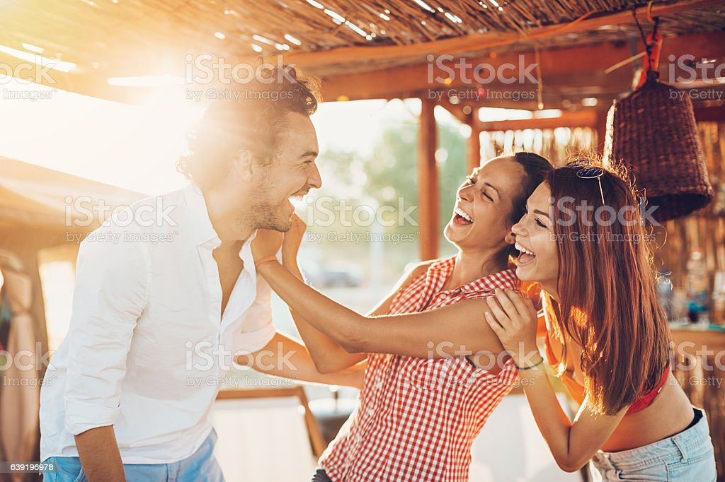 Cheerful young people in the summer stock photo
