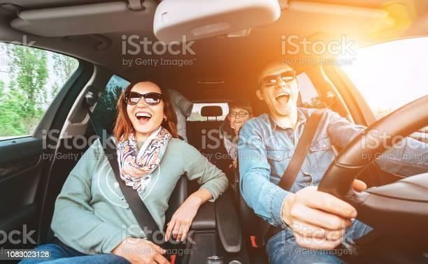 Cheerful young traditional family has a long auto journey and singing picture id1083023128?b=1&k=6&m=1083023128&s=612x612&h=ut7i5wpmfqsiguxov2wilj6rcnxri7cqssyqjmgkimi=