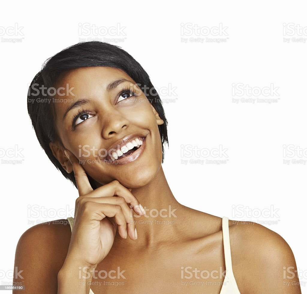 Cheerful young woman against white background - copyspace royalty-free stock photo