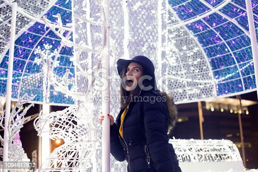 istock Cheerful young woman have a fun on city streets for Christmas 1094617612