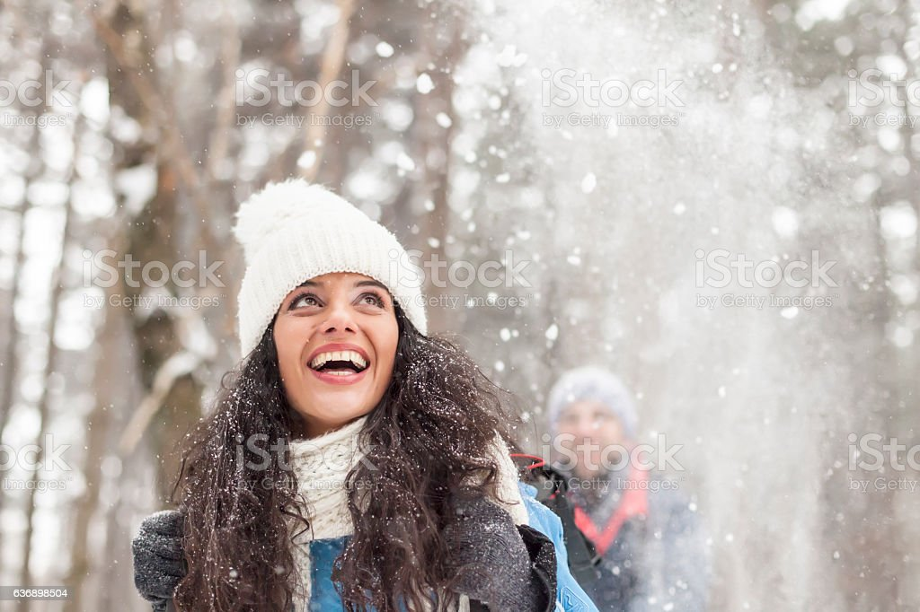 Cheerful young woman having fun in the snow forest – Foto