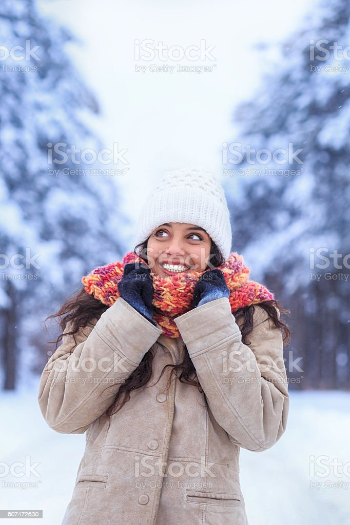 Cheerful young woman having fun on snow forest - foto de stock
