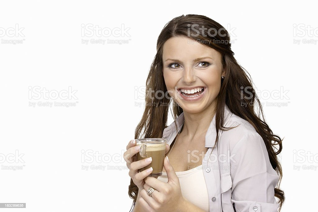 Cheerful young woman holding a glass of cocoa against white royalty-free stock photo