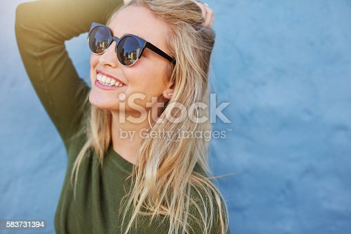 541271164 istock photo Cheerful young woman in sunglasses 583731394