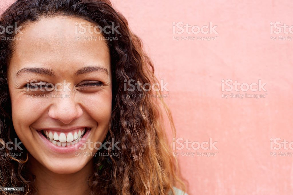 Cheerful young woman laughing stock photo