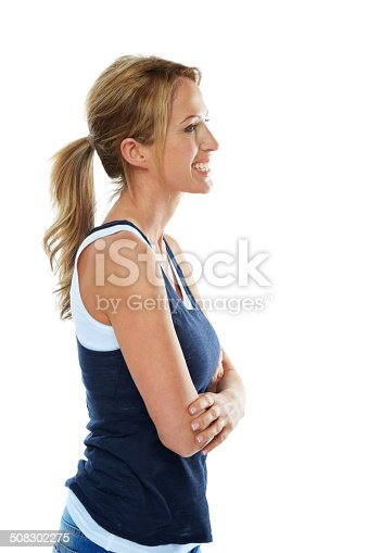 istock Cheerful young woman looking at copyspace 508302275
