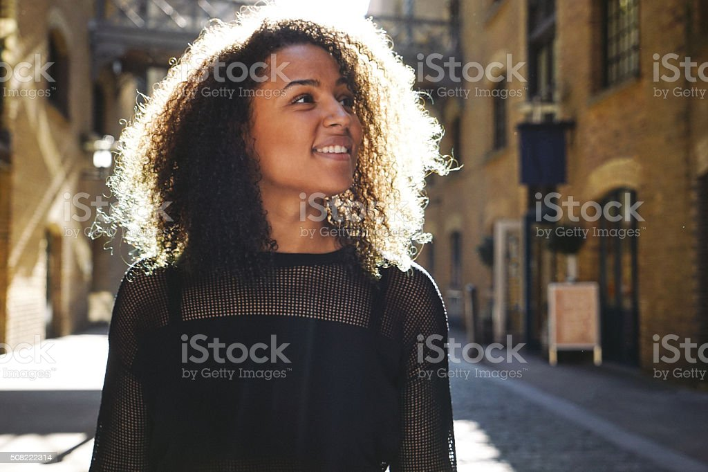 Cheerful Young Woman Portrait, Urban Landscape On Background stock photo