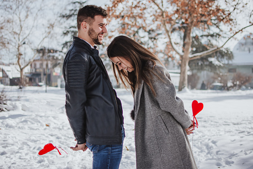 518335358 istock photo Cheerful young woman receiving a gift from her boyfriend 1133361426