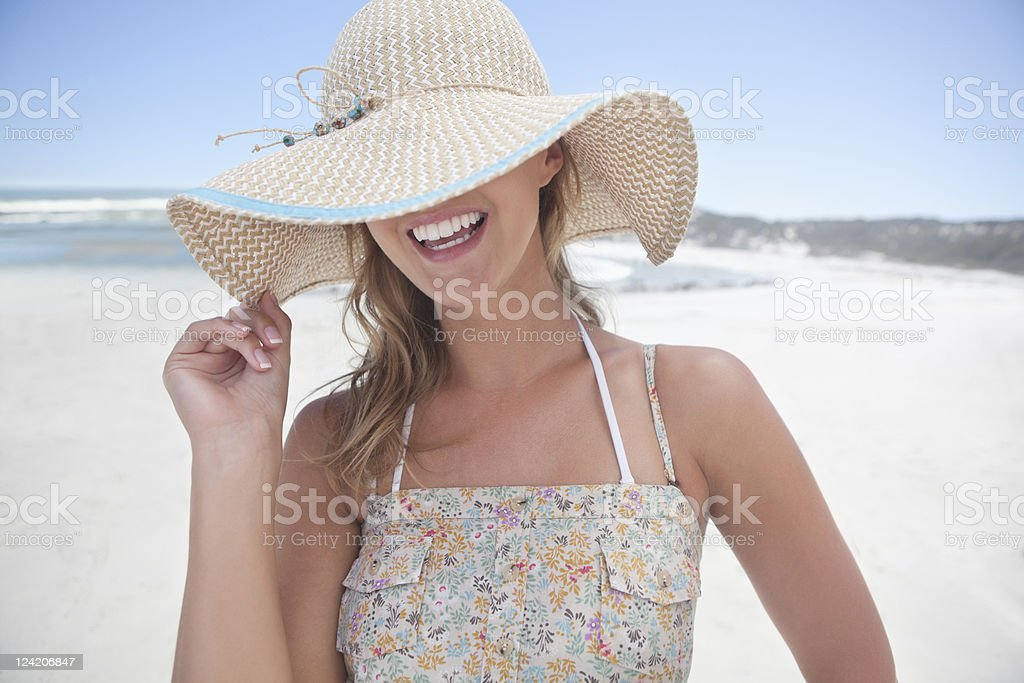 Cheerful young woman smiling at the beach royalty-free stock photo