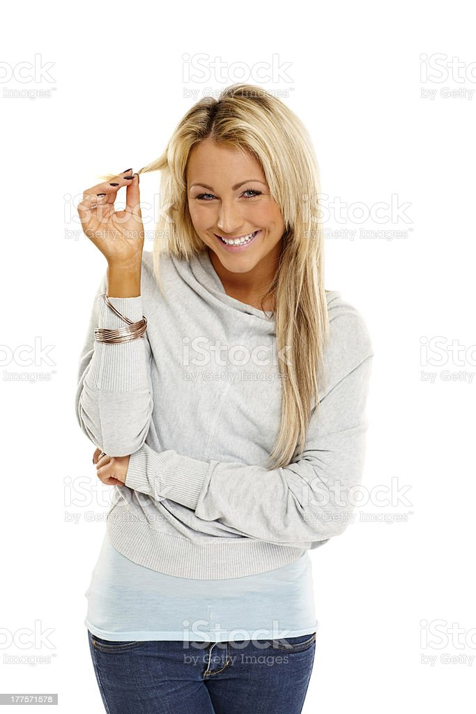Cheerful young woman standing on white royalty-free stock photo