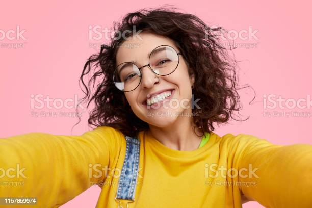 Cheerful young woman taking selfie picture id1157859974?b=1&k=6&m=1157859974&s=612x612&h=16tra0q6lrr9hwlr3yib4q5mxntmazp0pcepnar96 g=