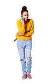 istock Cheerful young woman talking on cellphone and laughing 539466672