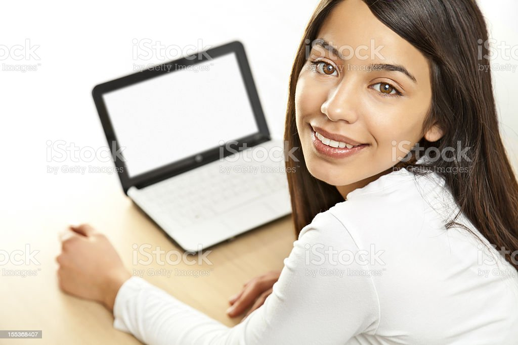 Cheerful young woman using netbook stock photo