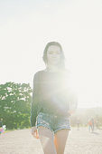 istock Cheerful Young Woman Walking Down Pathway In A Park 478707524