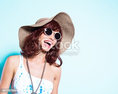 istock Cheerful young woman wearing swimsuit and sun hat 467587886