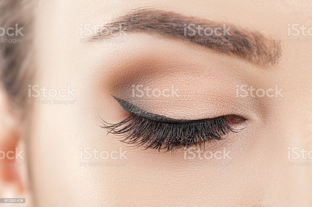 Cheerful young woman with beautiful make-up stock photo