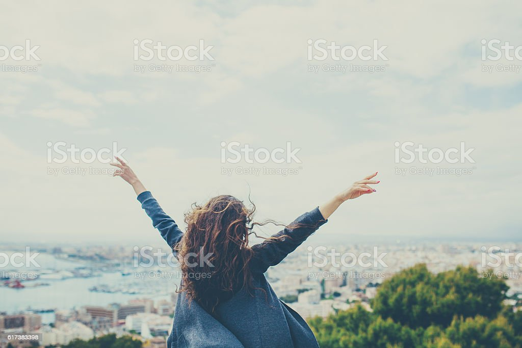 cheerful young woman with hands up. stock photo