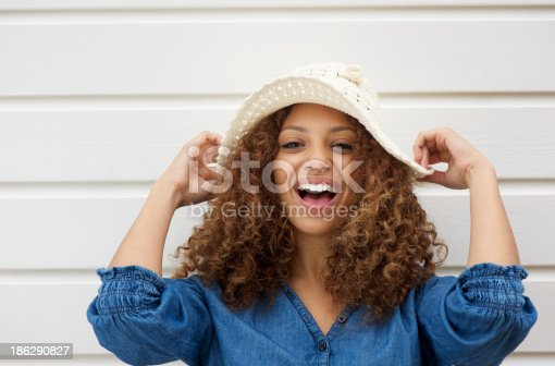 186534921 istock photo Cheerful young woman with hat laughing outdoors 186290827