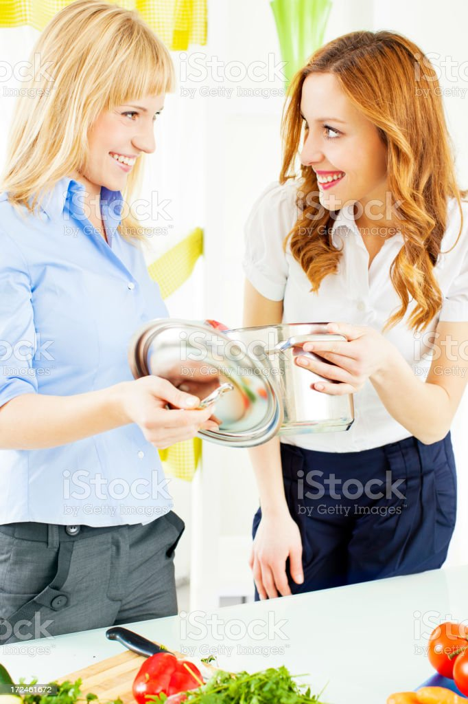 Cheerful Young Women Cooking together. royalty-free stock photo