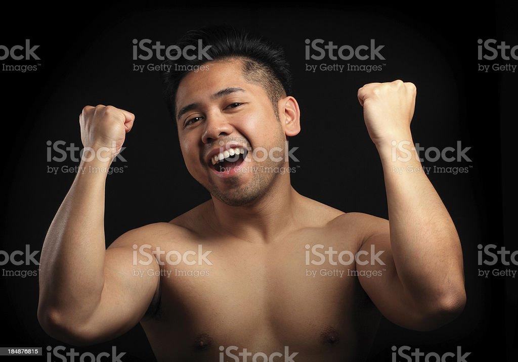Cheering asian man stock photo