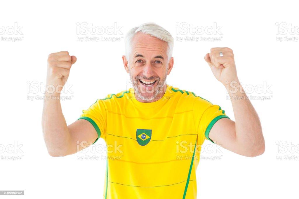 Torcendo o fã do futebol brasileiro em amarelo - foto de acervo