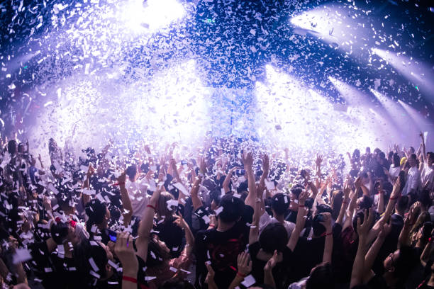 Cheering crowd at a concert Cheering crowd at a concert nightclub stock pictures, royalty-free photos & images