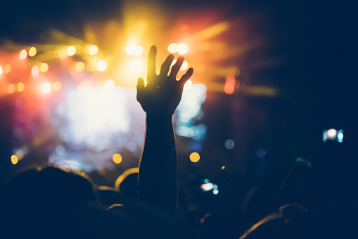 istock Cheering crowd at concert enjoying music performance 1149266100