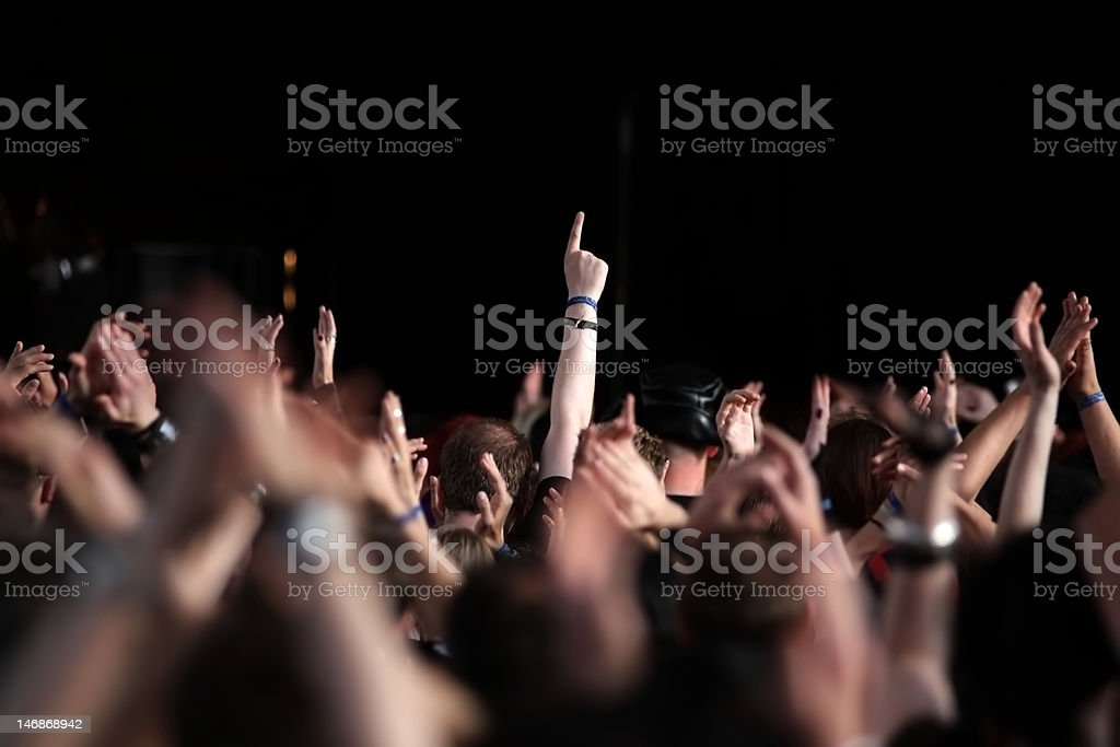 cheering crowd raising their hands in the air royalty-free stock photo