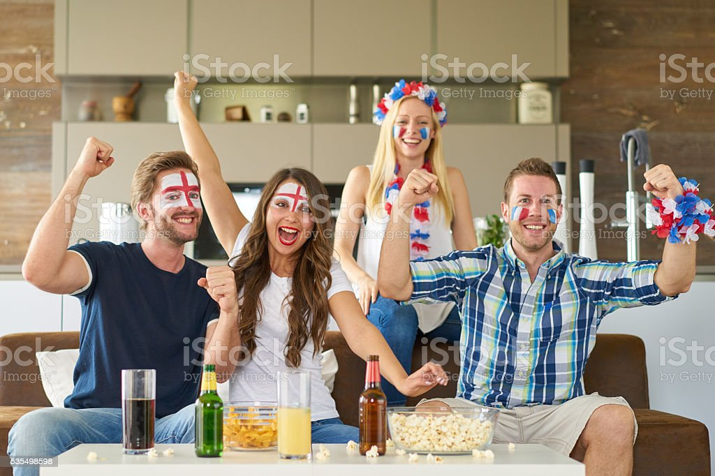 cheering english and french soccer fans stock photo
