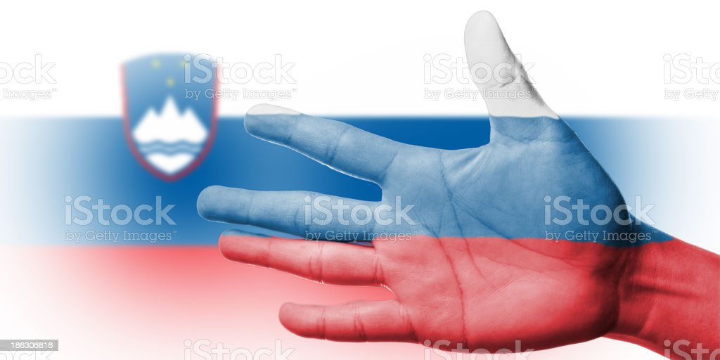 Cheering fan with Painting national Slovenia flag royalty-free stock photo