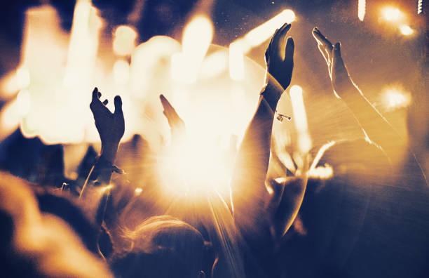 Cheering fans at concert picture id1069137774?b=1&k=6&m=1069137774&s=612x612&w=0&h=mnijkzdxk f8bpfxjuejluw8mszrn2nhrh7o7zp1hb0=