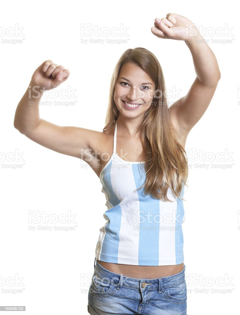 Cheering female argentinian football fan stock photo