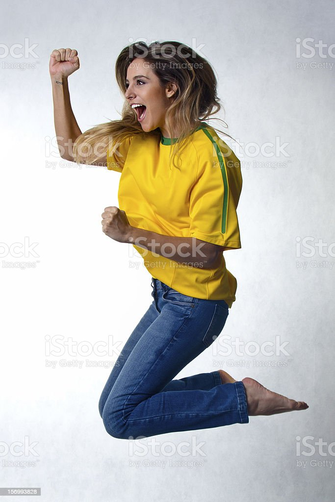 Cheering for Brazil soccer team royalty-free stock photo