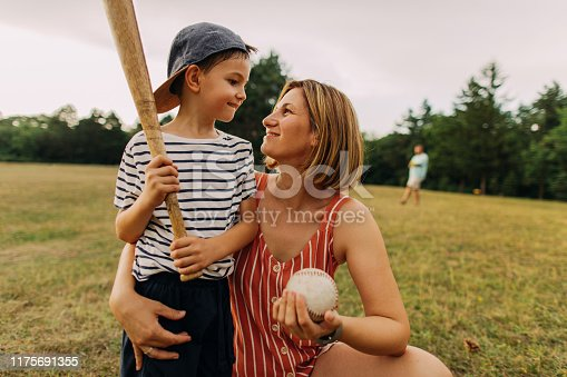 Photo of a little boy, baseball player, who needed some cheering and courage from his mother.