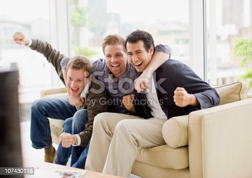istock Cheering friends watching television 107430118
